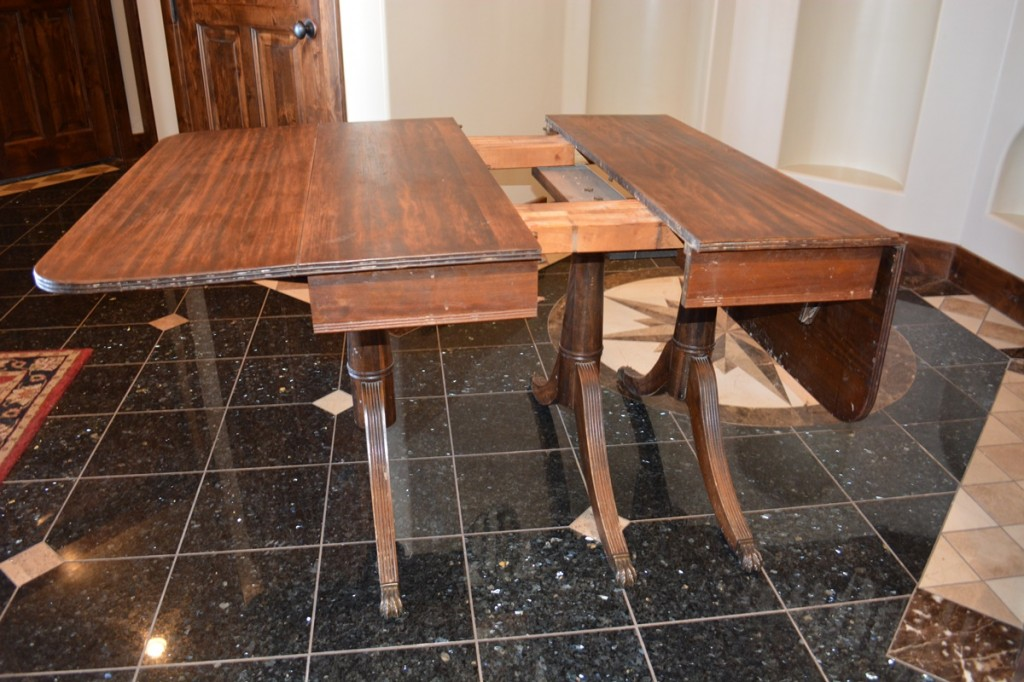 "Our ""unfinished"" kitchen table (as the house which we were remodeling) was used symbolically for our ""unfinished"" family in the book. Amy found the antique Duncan Phyfe mahogany drop leaf claw foot table at a garage sale."