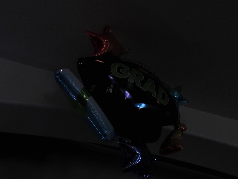00012 graduation balloons in dark