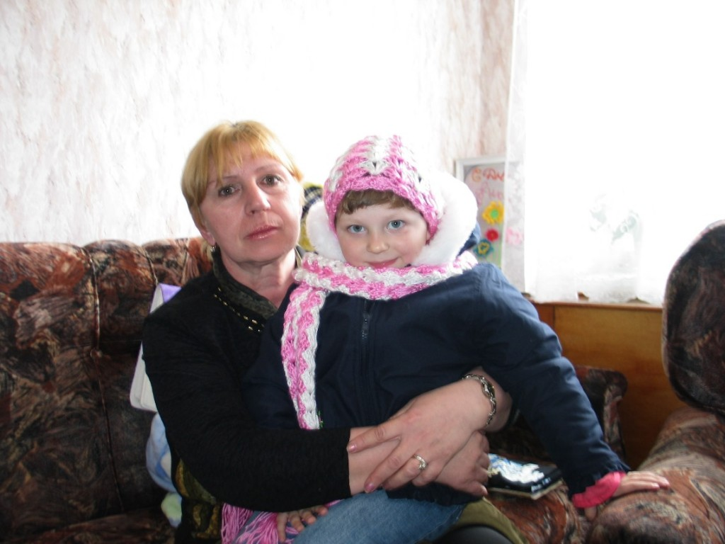 Katya with one of the orphanage workers, just before she left, forever.