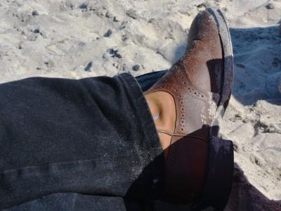 John M Simmons on the beach
