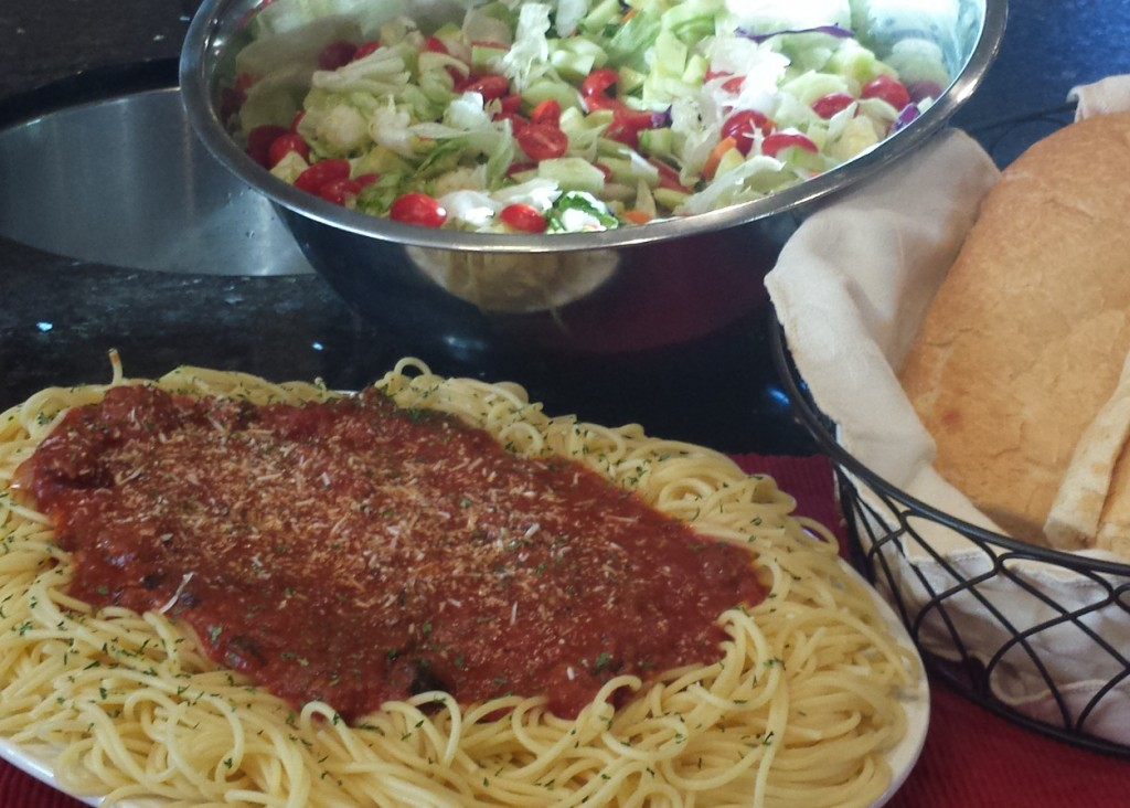 Monster Spaghetti, green Salad and garlic bread served family style.