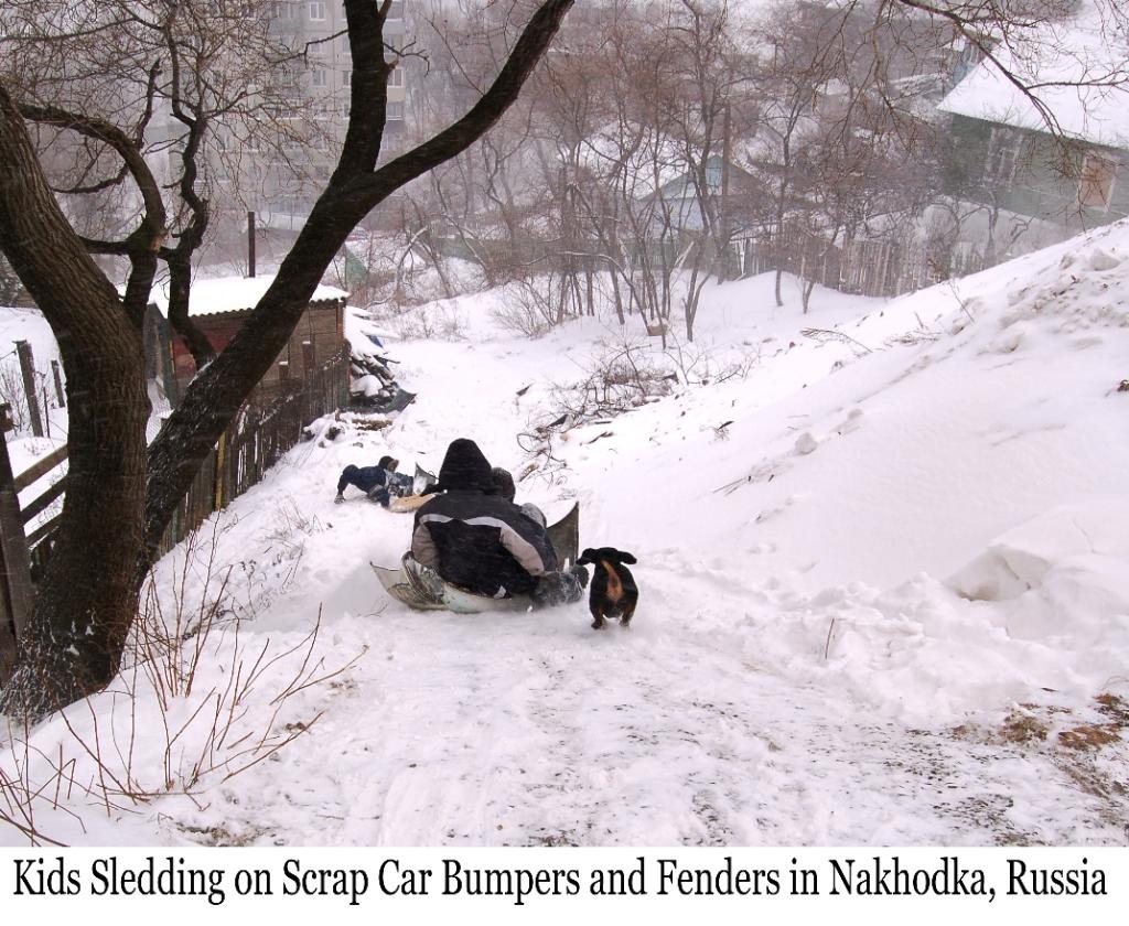 Kids Sledding on car Bumper in Nakhodka, Russia